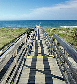 a walkway stretches toward the ocean in North Litchfield