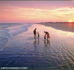 A couple with children on the beach at Seabrook Island, SC