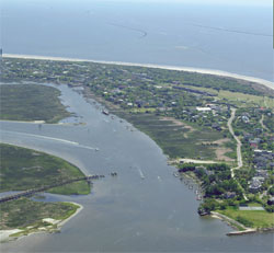An aerial photo of Sullivan's Island, SC showing a waterway and the Atlantic Ocean